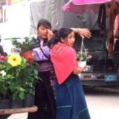 Two girls and a flower cart.